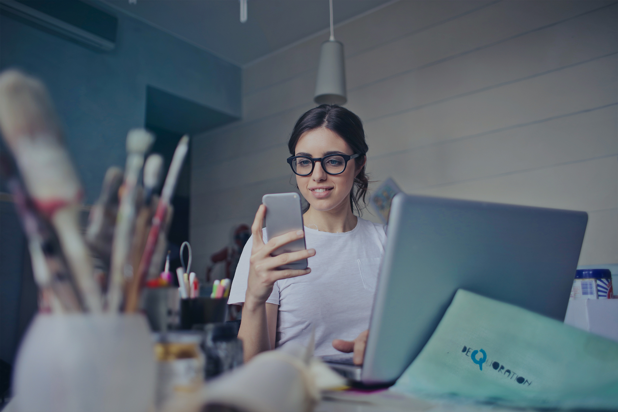 Woman with a cellphone at work